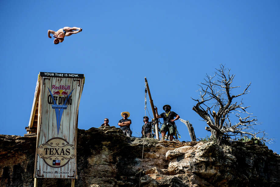 David Colturi of the USA dives from the 28-meter platform at Hells Gate during the second training session of the second stop of the Red Bull Cliff Diving World Series on June 6, 2014 in Possum Kingdom Lake, Texas. Photo: Handout, Red Bull Via Getty Images / 2014 Red Bull