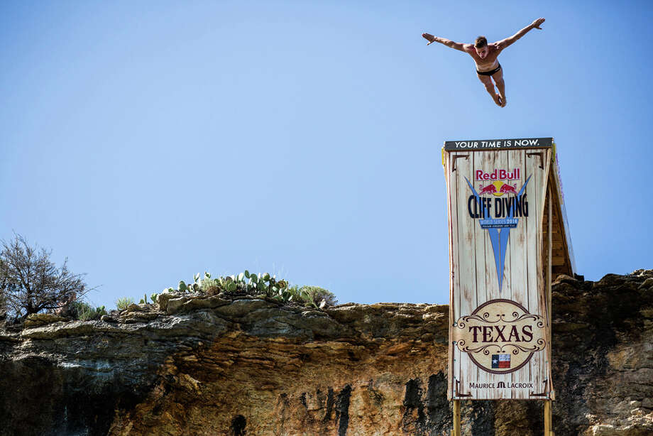Artem Silchenko of Russia dives from the 28-meter platform at Hells Gate during the second training session of the second stop of the Red Bull Cliff Diving World Series on June 6, 2014 in Possum Kingdom Lake, Texas. Photo: Handout, Red Bull Via Getty Images / 2014 Red Bull