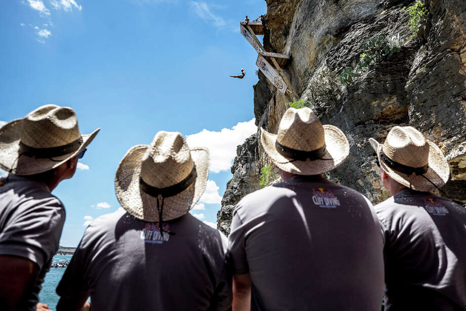 The judges watch on as Cesilie Carlton of the USA dives from the 20-meter platform at Hells Gate during the second training session of the second stop of the Red Bull Cliff Diving World Series on June 6, 2014 in Possum Kingdom Lake, Texas. Photo: Handout, Red Bull Via Getty Images / 2014 Red Bull
