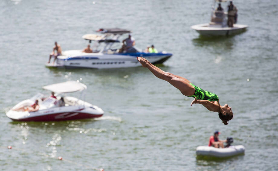 Adriana Jimenez of Mexico dives from the 20-meter platform at Hells Gate during the first training session of the second stop of the Red Bull Cliff Diving World Series on June 6, 2014 in Possum Kingdom Lake, Texas. Photo: Handout, Red Bull Via Getty Images / 2014 Red Bull
