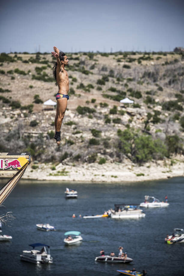 Orlando Duque of Colombia dives from the 28-meter platform at Hells Gate during the first round of the second stop of the Red Bull Cliff Diving World Series on June 6, 2014 in Possum Kingdom Lake, Texas. Photo: Handout, Red Bull Via Getty Images / 2014 Red Bull
