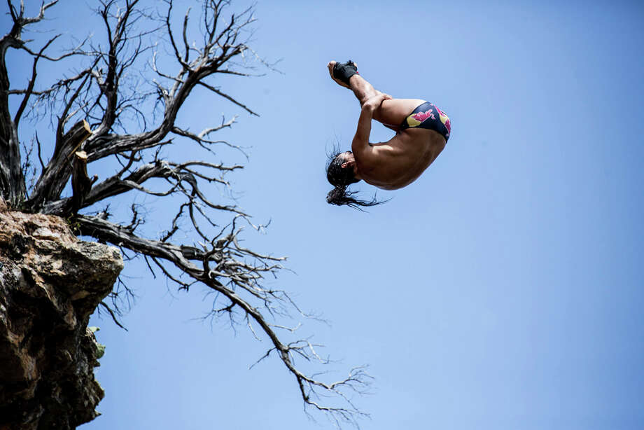 Orlando Duque of Colombia dives from the 28-meter platform at Hells Gate during the second stop of the Red Bull Cliff Diving World Series on June 7, 2014 in Possum Kingdom Lake, Texas. Photo: Handout, Red Bull Via Getty Images / 2014 Red Bull