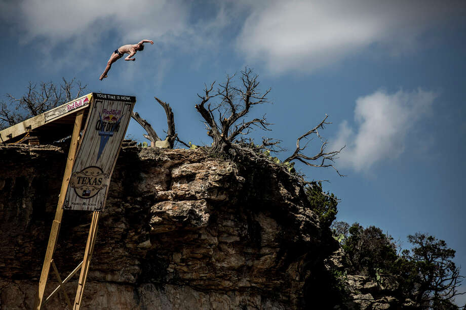 Gary Hunt of the UK dives from the 28-meter platform at Hells Gate during the second stop of the Red Bull Cliff Diving World Series on June 7, 2014 in Possum Kingdom Lake, Texas. Photo: Handout, Red Bull Via Getty Images / 2014 Red Bull
