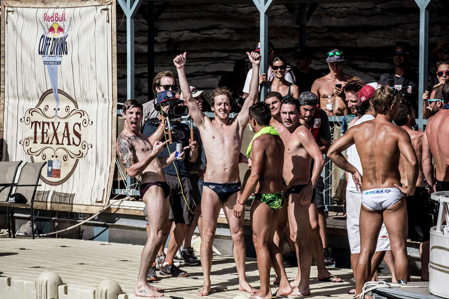Gary Hunt (center) of the UK celebrates on the judges boat at Hells Gate during the second stop of the Red Bull Cliff Diving World Series on June 7, 2014 in Possum Kingdom Lake, Texas. Photo: Handout, Red Bull Via Getty Images / 2014 Red Bull