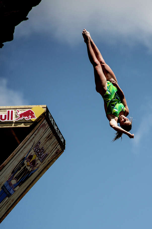 Rachelle Simpson of the USA dives from the 28-meter platform at Hells Gate during the second stop of the Red Bull Cliff Diving World Series on June 7, 2014 in Possum Kingdom Lake, Texas. Photo: Handout, Red Bull Via Getty Images / 2014 Red Bull
