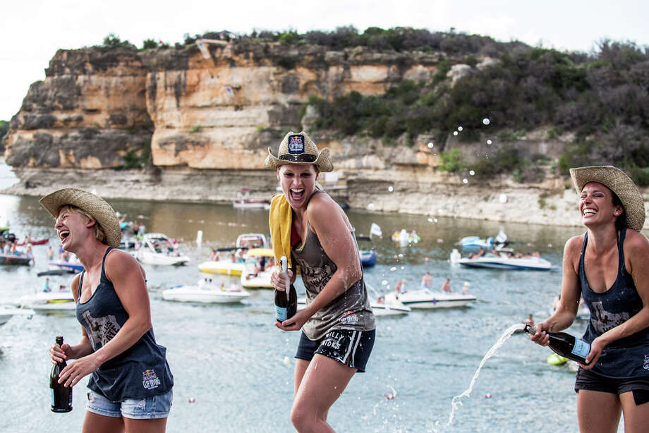 Cesilie Carlton (from left) and Rachelle Simpson of the USA, and Anna Bader of Germany celebrate on the podium at Hells Gate during the second stop of the Red Bull Cliff Diving World Series on June 7, 2014 in Possum Kingdom Lake, Texas. Photo: Handout, Red Bull Via Getty Images / 2014 Red Bull