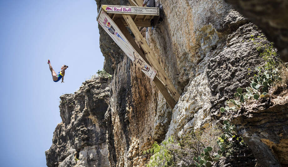 Jacqueline Valente of Brazil dives from the 20-meter platform at Hells Gate during the second stop of the Red Bull Cliff Diving World Series, Possum Kingdom Lake, Texas, USA. Photo: Handout, Red Bull Via Getty Images / 2014 Red Bull