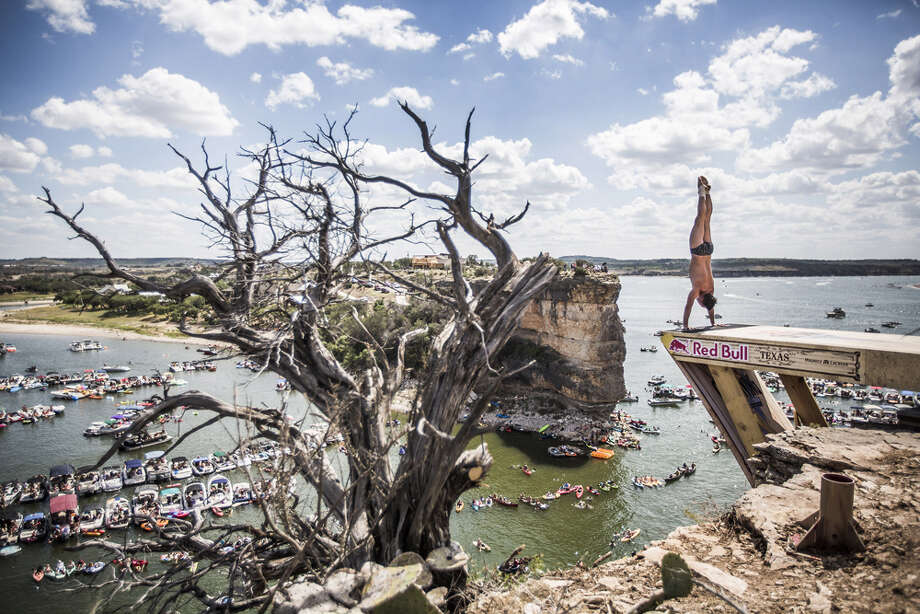 Blake Aldridge of the UK prepares to launch an armstand dive from the 28-meter platform at Hells Gate during the second stop of the Red Bull Cliff Diving World Series, Possum Kingdom Lake, Texas, USA. Photo: Handout, Red Bull Via Getty Images / 2014 Red Bull