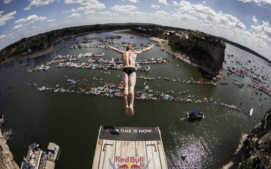 Andy Jones of the USA dives from the 28-meter platform at Hells Gate during the second stop of the Red Bull Cliff Diving World Series, Possum Kingdom Lake, Texas, USA. Photo: Handout, Red Bull Via Getty Images / 2014 Red Bull