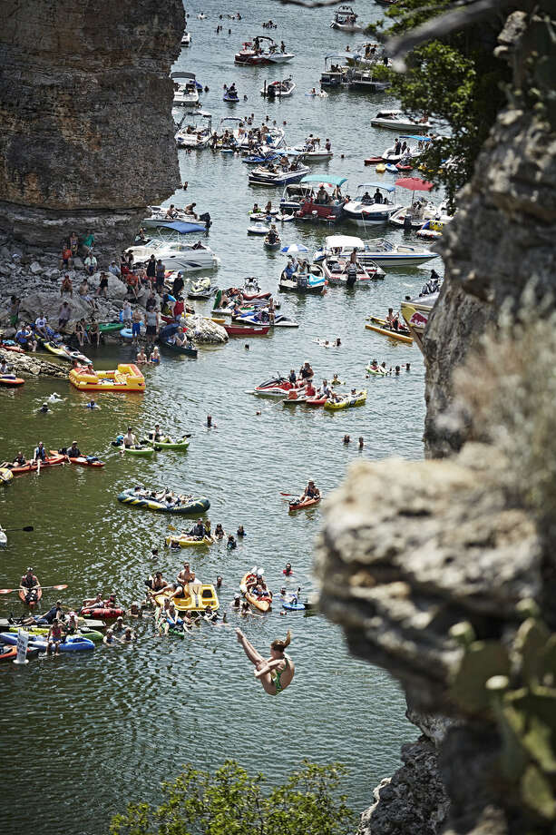 Rachelle Simpson of the USA dives from the 20-meter platform at Hells Gate during the second stop of the Red Bull Cliff Diving World Series at Possum Kingdom Lake, Texas, on June 7, 2014. Photo: Balazs Gardi, Courtesy Of Red Bull Cliff Diving / Balazs Gardi/Red Bull Cliff Diving