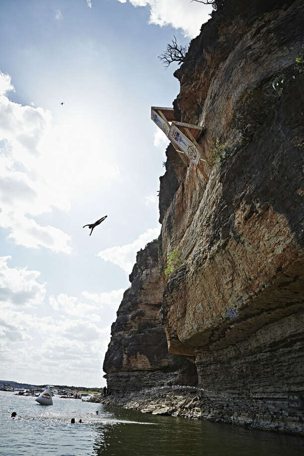 Artem Silchenko of Russia dives from the 28-meter platform at Hells Gate during the second stop of the Red Bull Cliff Diving World Series at Possum Kingdom Lake, Texas, on June 7, 2014. Photo: Balazs Gardi, Courtesy Of Red Bull Cliff Diving / Balazs Gardi/Red Bull Cliff Diving