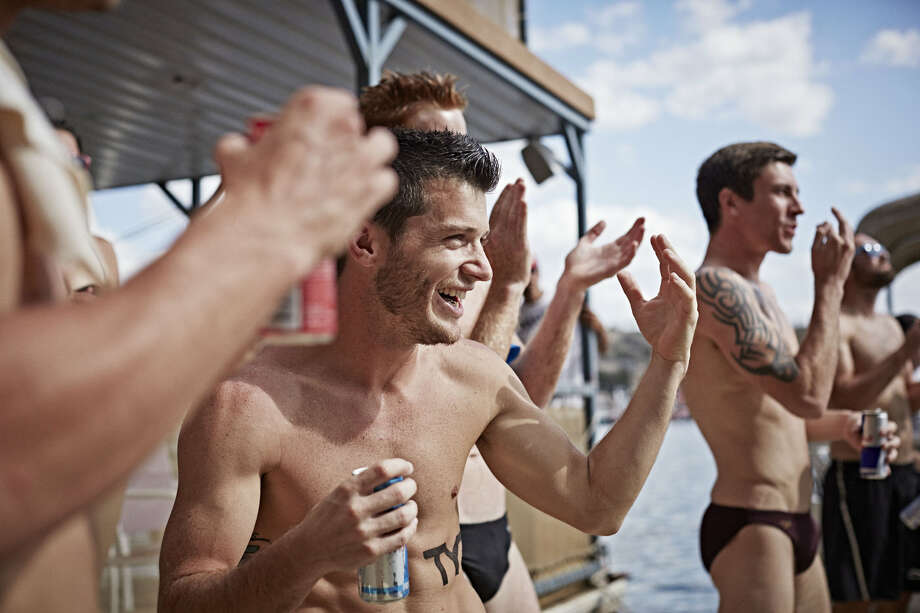 Steven LoBue of the USA watch Gary Hunt of the UK dive from the 28-meter platform at Hells Gate during the second stop of the Red Bull Cliff Diving World Series at Possum Kingdom Lake, Texas, on June 7, 2014. Photo: Balazs Gardi, Courtesy Of Red Bull Cliff Diving / Balazs Gardi/Red Bull Cliff Diving