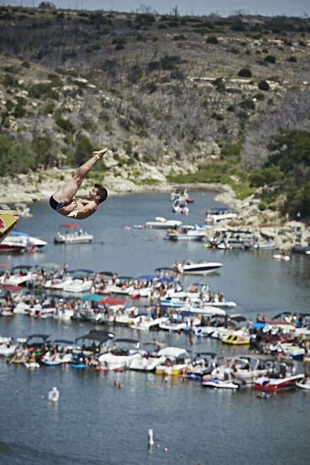 Steven LoBue of the USA dives from the 28-meter platform at Hells Gate during the second stop of the Red Bull Cliff Diving World Series at Possum Kingdom Lake, Texas, on June 7, 2014. Photo: Balazs Gardi, Courtesy Of Red Bull Cliff Diving / Balazs Gardi/Red Bull Cliff Diving