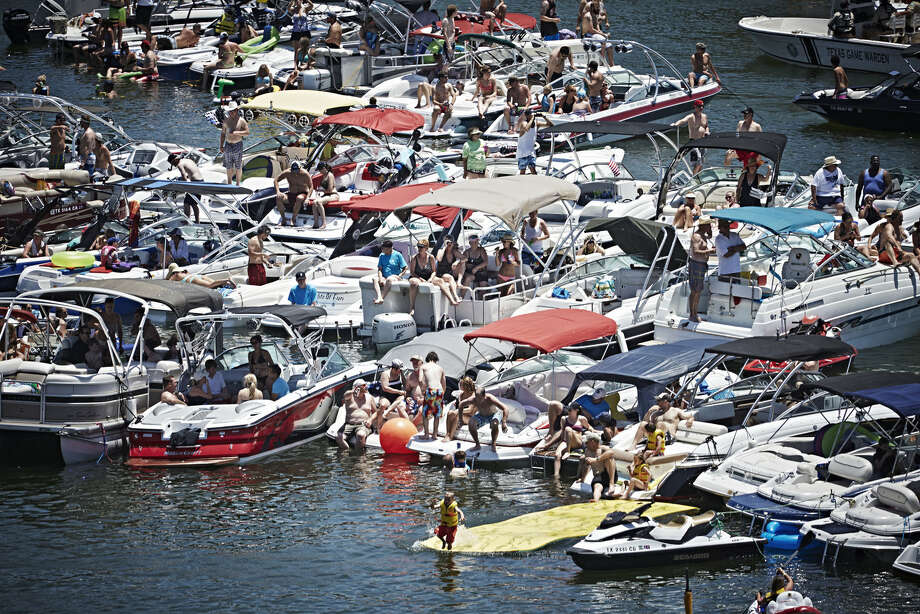 Spectators watch the second stop of the Red Bull Cliff Diving World Series at Possum Kingdom Lake, Texas, on June 7, 2014. Photo: Balazs Gardi, Courtesy Of Red Bull Cliff Diving / Balazs Gardi/Red Bull Cliff Diving