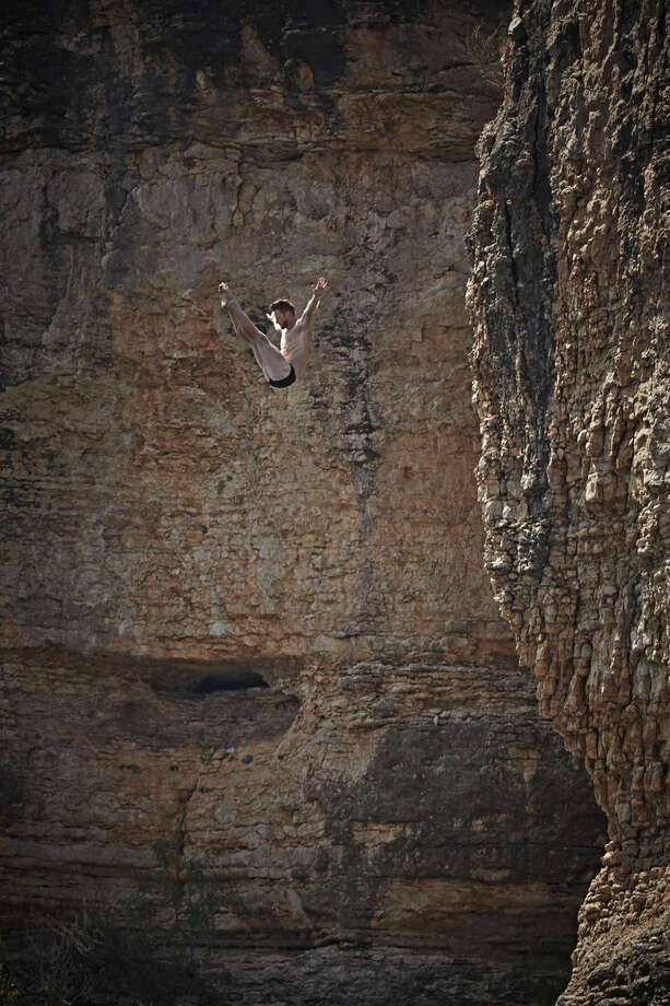 Andy Jones of the USA dives from the 28-meter platform at Hells Gate during the second stop of the Red Bull Cliff Diving World Series at Possum Kingdom Lake, Texas, on June 7, 2014. Photo: Balazs Gardi, Courtesy Of Red Bull Cliff Diving / Balazs Gardi/Red Bull Cliff Diving