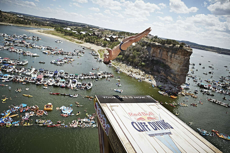 David Colturi of the USA dives from the 28-meter platform at Hells Gate during the second stop of the Red Bull Cliff Diving World Series at Possum Kingdom Lake, Texas, on June 7, 2014. Photo: Balazs Gardi, Courtesy Of Red Bull Cliff Diving / Balazs Gardi/Red Bull Cliff Diving