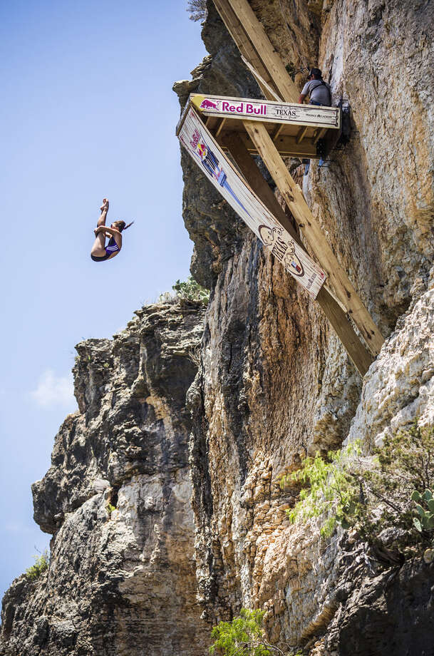 Tara Hyer-Tira of the USA dives from the 20-meter platform at Hells Gate during the second stop of the Red Bull Cliff Diving World Series, Possum Kingdom Lake, Texas, on June 7, 2014. Photo: Romina Amato, Courtesy Of Red Bull Cliff Diving / Romina Amato / Red Bull