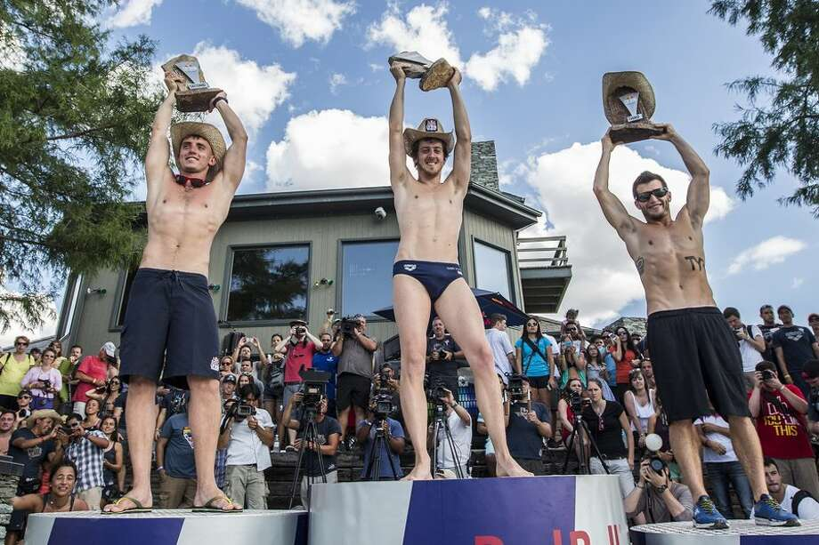 Artem Silchenko (from left) of Russia, Gary Hunt of the UK and Steven LoBue of the USA,  celebrate on the podium at Hells Gate during the second stop of the Red Bull Cliff Diving World Series, Possum Kingdom Lake, Texas, on June 7, 2014. Photo: Romina Amato, Courtesy Of Red Bull Cliff Diving