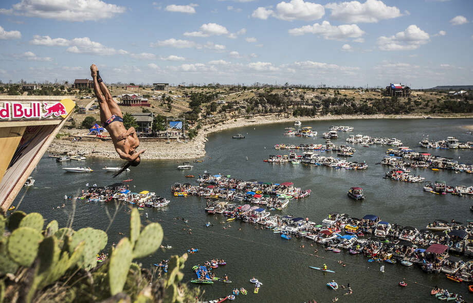 Orlando Duque of Colombia dives from the 28-meter platform at Hells Gate during the second stop of the Red Bull Cliff Diving World Series, Possum Kingdom Lake, Texas, on June 7, 2014. Photo: Romina Amato, Courtesy Of Red Bull Cliff Diving / Romina Amato / Red Bull