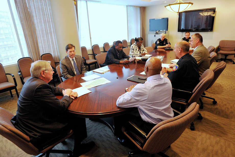 "Mayor David Martin, left, presides over a meeting with clockwise from top left: John Freeman, attorney and spokesperson for BLT; Terry Adams, District 3 Representative; Elise Coleman, District 3 Representative; Stamfod Police Captain Tom Wuennemann; Asst. Police Chief Jim Matheny; Ted Jankowski, director of public safety; Police Chief Jon Fontneau; and Michael Pollard, mayor's chief of staff at the Stamford Government Center in Stamford, Conn., on Monday, June 9, 2014 in response to the murder of 46-year-old William ""Buttons"" James last Thursday on Stamford's South End. Photo: Jason Rearick / Stamford Advocate"