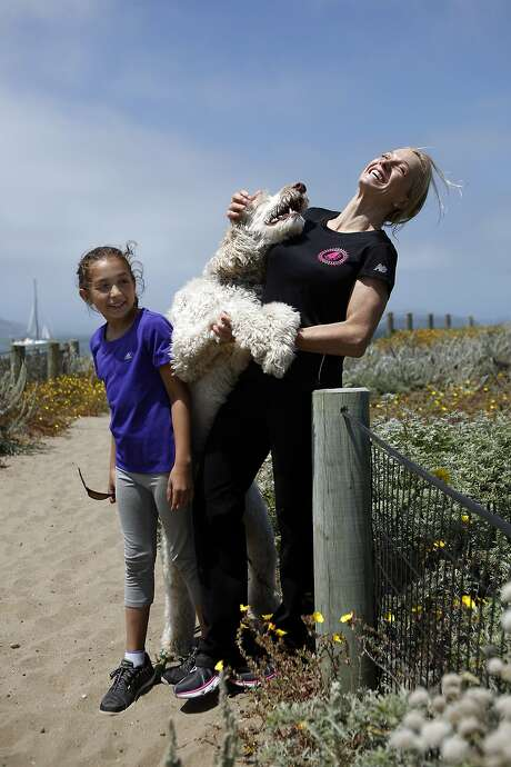 Dr. Pamela Munster, a UCSF breast cancer specialist diagnosed with breast cancer, poses for a portrait with her daughter Maya Daud, 10, and their dog Sampson at Crissy Field in San Francisco, CA, Saturday June 7, 2014. Photo: Michael Short, The Chronicle