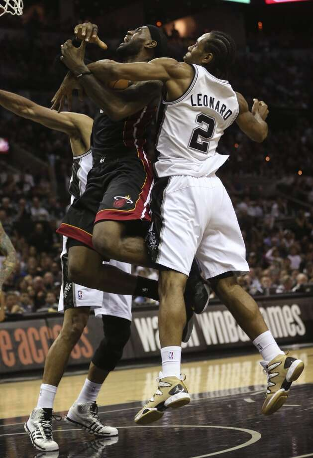 Miami Heat's LeBron James is fouled by San Antonio Spurs' Kawhi Leonard during the second half in game two of the NBA Finals at the AT&T Center, Sunday, June 8, 2014. The Heat won 98-96 to tie the series at 1-1. Photo: Jerry Lara, San Antonio Express-News
