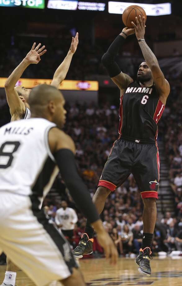 Miami Heat's LeBron James scores against the San Antonio Spurs during the second half in game two of the NBA Finals at the AT&T Center, Sunday, June 8, 2014. The Heat won 98-96 to tie the series at 1-1. Photo: Jerry Lara, San Antonio Express-News