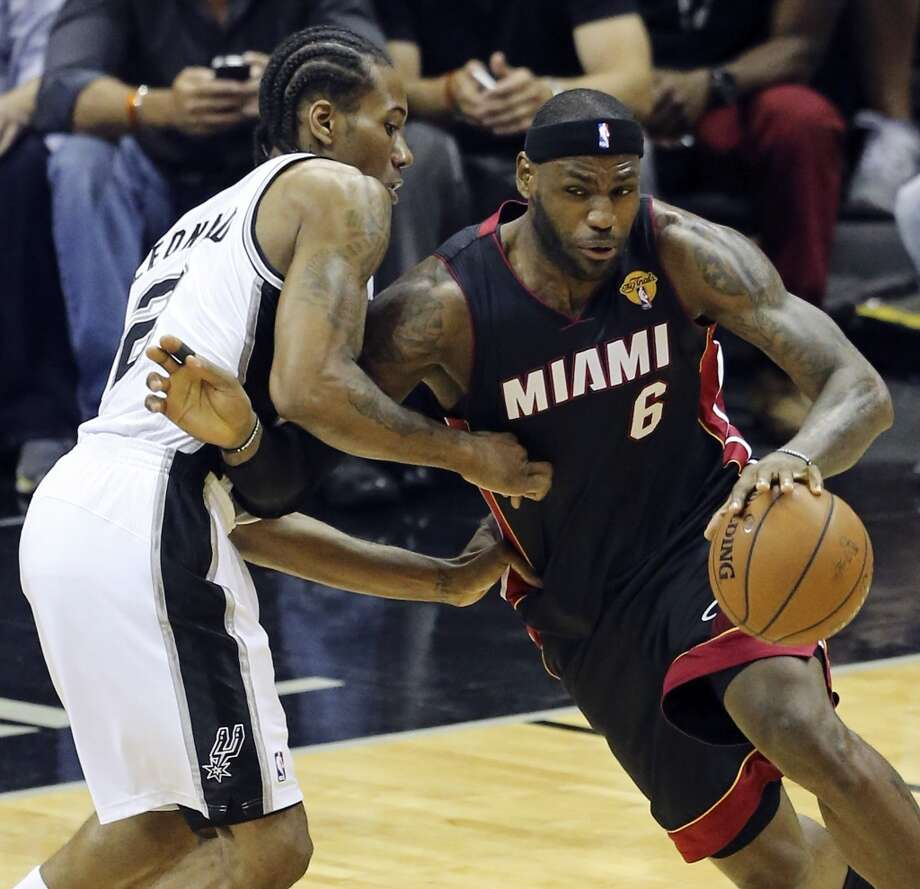 San Antonio Spurs' Kawhi Leonard defends Miami Heat's LeBron James during first half action in Game 2 of the NBA Finals Sunday June 8, 2014 at the AT&T Center. Photo: Edward A. Ornelas, San Antonio Express-News