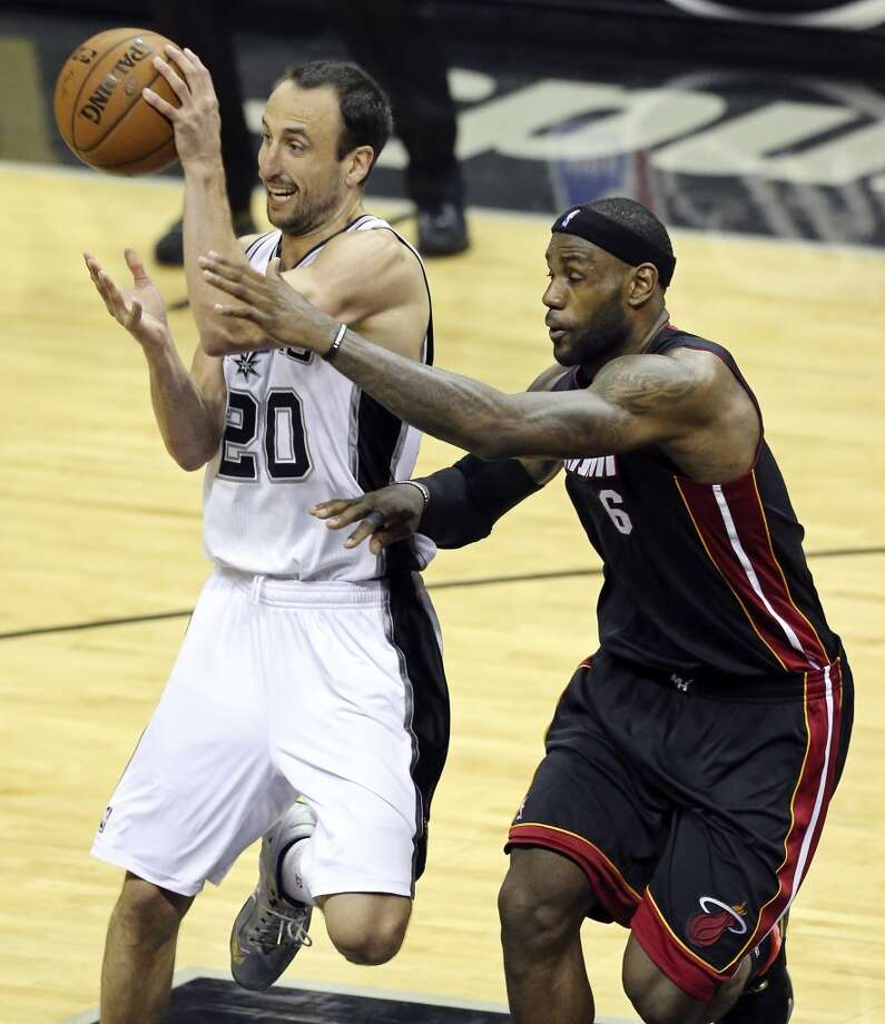 San Antonio Spurs' Manu Ginobili passes around Miami Heat's LeBron James during second half action in Game 2 of the NBA Finals Sunday June 8, 2014 at the AT&T Center. The Heat won 98-96. Photo: Edward A. Ornelas, San Antonio Express-News