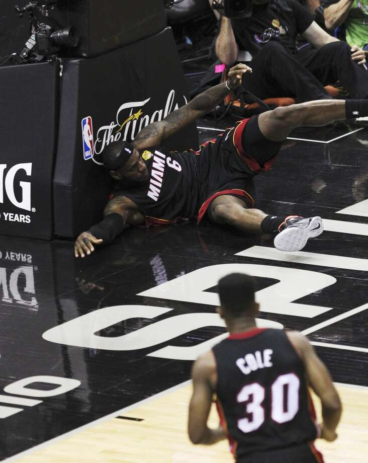 Miami Heat's LeBron James (06) slams against the stanchion after a botched play against the Spurs in the first half of Game 2 of the 2014 NBA Finals at the AT&T Center on Sunday, June 8, 2014. Photo: Kin Man Hui, San Antonio Express-News