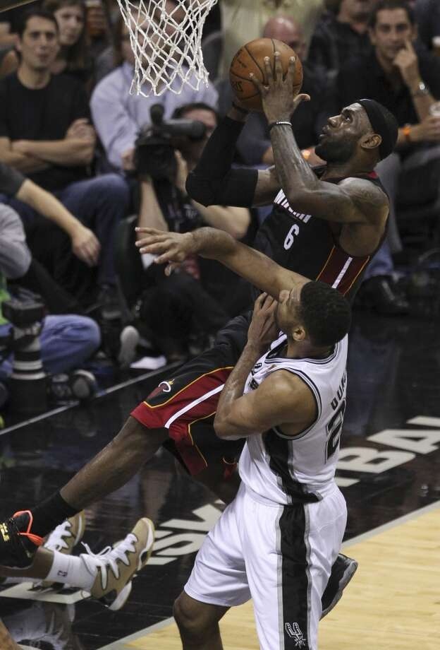 Miami Heat's LeBron James (06) goes up for a shot against Spurs' Tim Duncan (21) in the first half of Game 2 of the 2014 NBA Finals at the AT&T Center on Sunday, June 8, 2014. Photo: Kin Man Hui, San Antonio Express-News