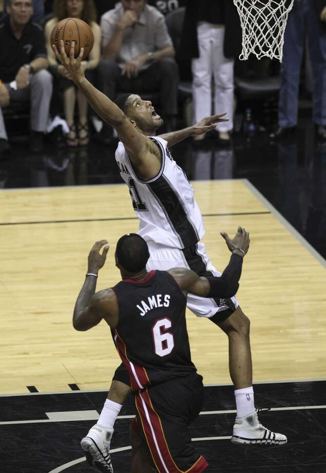 Spurs' Tim Duncan (21) goes up for shot against Miami Heat's LeBron James (06) in the first half of Game 2 of the 2014 NBA Finals at the AT&T Center on Sunday, June 8, 2014. Photo: Kin Man Hui, San Antonio Express-News