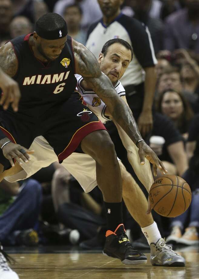 San Antonio Spurs' Manu Ginobili puts pressure on Miami Heat's LeBron James during the first half in game two of the NBA Finals at the AT&T Center, Sunday, June 8, 2014. Photo: Jerry Lara, San Antonio Express-News