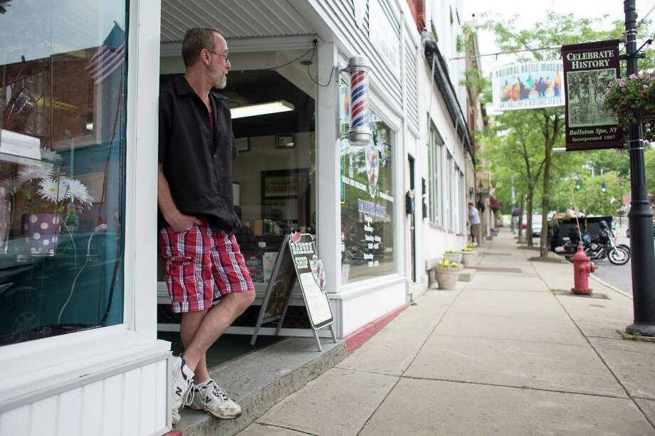 Dan Woycik takes a break from cutting hair outside of Straight Edge Barber Shop Monday, June 9, 2014, on Milton Avenue in Ballston Spa, N.Y.  (Tom Brenner/ Special to the Times Union) Photo: Tom Brenner / ©Tom Brenner/ Albany Times Union