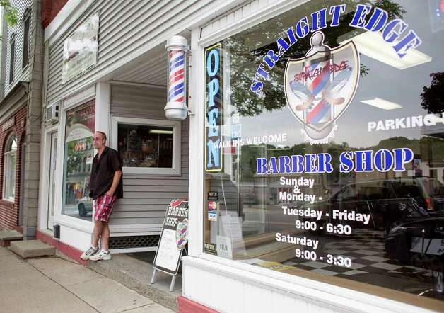 Barber Shop In Walmart : takes a break from cutting hair outside of Straight Edge Barber Shop ...
