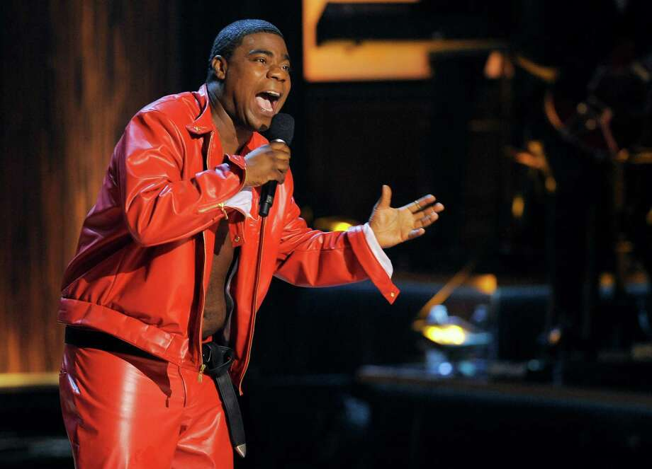 """FILE - In this Nov. 3, 2012 file photo, comedian Tracy Morgan performs at """"Eddie Murphy: One Night Only,"""" a celebration of Murphy's career at the Saban Theater in Beverly Hills, Calif. Morgan is recovering but is expected to remain hospitalized for several weeks after having surgery on a broken leg suffered in a chain-reaction crash on the New Jersey Turnpike early Saturday, June 7, 2014, that left two others critically injured and one dead. (Photo by Chris Pizzello/Invision, File) Photo: Chris Pizzello, INVL / Invision"""