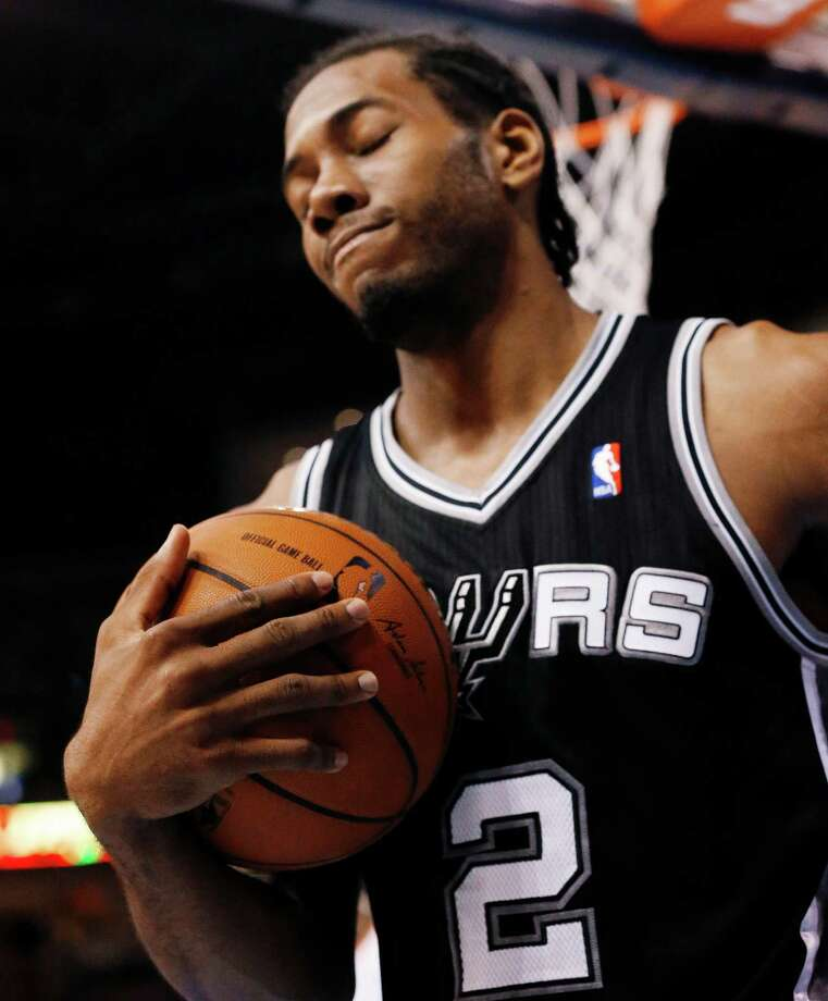 San Antonio Spurs forward Kawhi Leonard reacts during the second half against the Oklahoma City Thunder in Game 6 of the Western Conference finals NBA basketball playoff series in Oklahoma City, Saturday, May 31, 2014. (AP Photo/Sue Ogrocki) Photo: Sue Ogrocki, STF / AP