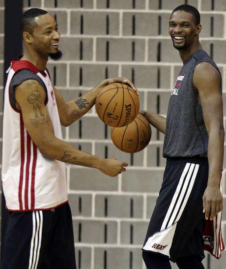 Heat forward Rashard Lewis (left), joking with Chris Bosh, has averaged 13.8 points in his last four games. Photo: Edward A. Ornelas / San Antonio Express-News / © 2014 San Antonio Express-News