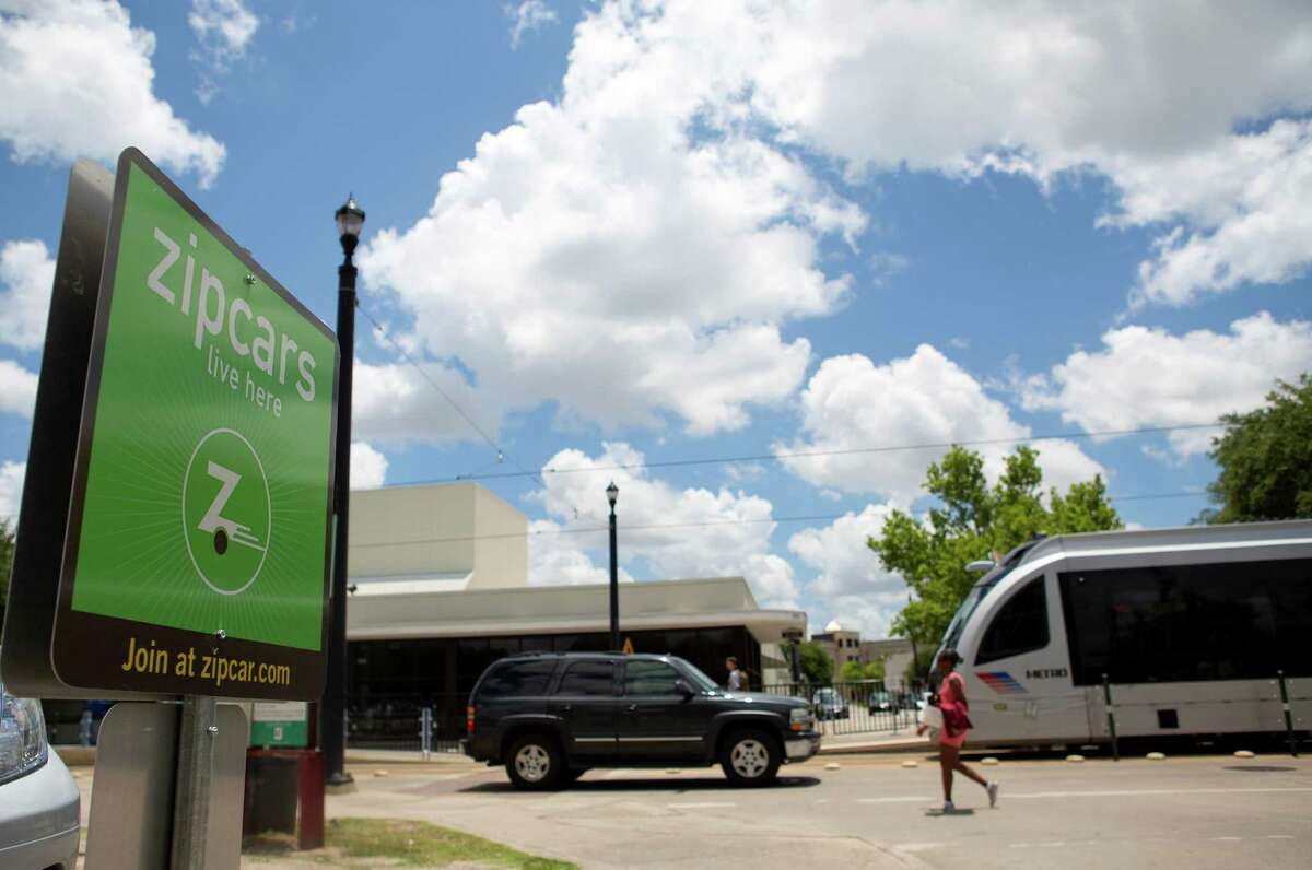 A sign for Zipcars is seen Friday at Main and Berry Streets The City Council plans to discuss taxicode changes on Wednesday, which could open new options while possibly disrupting the cab industry.