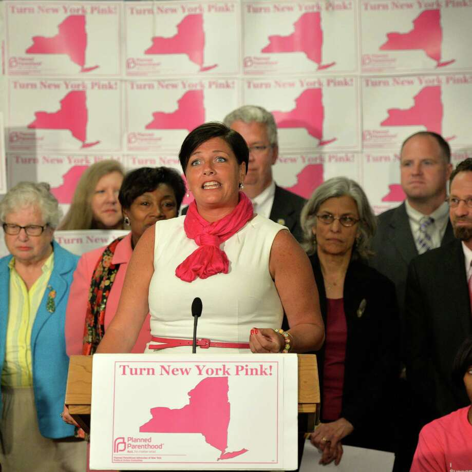 M. Tracey Brooks, president and CEO of Planned Parenthood Advocates of New York, at the podium announces a newly created Political Action Committee to support candidates across the state who affirm women's reproductive health rights during a press conference held Monday afternoon June 9, 2014 in Albany, N.Y.      (Skip Dickstein / Times Union) Photo: SKIP DICKSTEIN / 00027270A