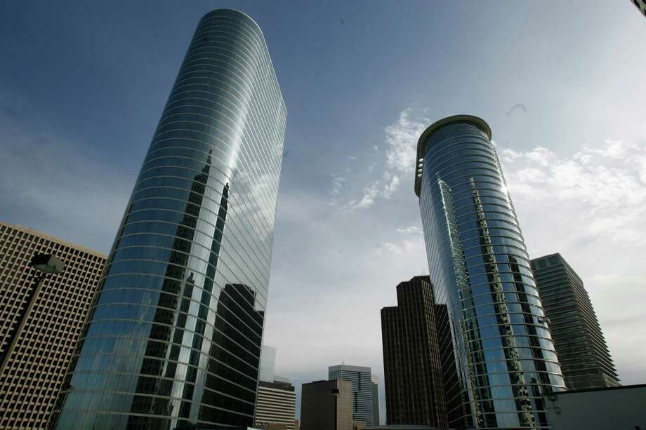 A Chevron spokesman stressed the company's commitment to downtown Houston. Chevron already owns two skyscrapers there but said last year it was delaying construction of another office tower downtown. Photo: Nick De La Torre, STAFF / Houston Chronicle