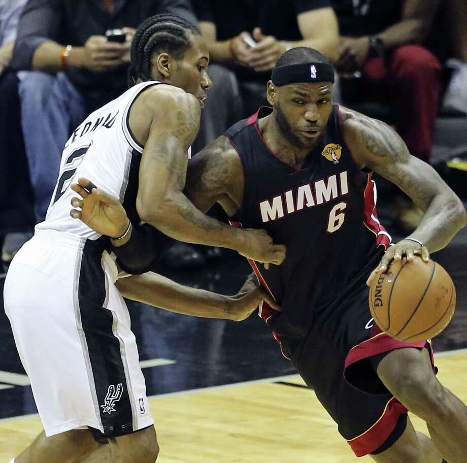 Spurs forward Kawhi Leonard fouled out while doing what he could to defend the Miami Heat's LeBron James in Game 2. Photo: Edward A. Ornelas / San Antonio Express-News / © 2014 San Antonio Express-News