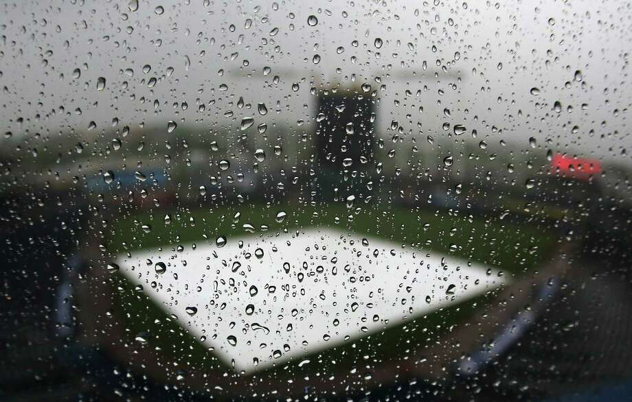 KANSAS CITY, MO - JUNE 9:  Rain drops bead off of the Kauffman Stadium press box window on June 9, 2014 in Kansas City, Missouri. A game between the New York Yankees and Kansas City Royals was postponed due to weather. (Photo by Ed Zurga/Getty Images) ORG XMIT: 477584711 Photo: Ed Zurga / 2014 Getty Images