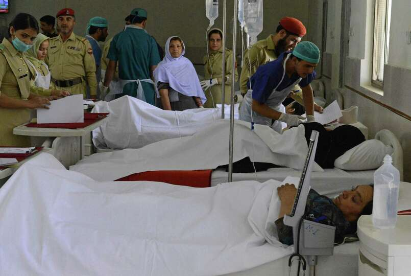 Pakistani army doctors attend victims of a suicide attack, at a military hospital in Quetta, Pakista