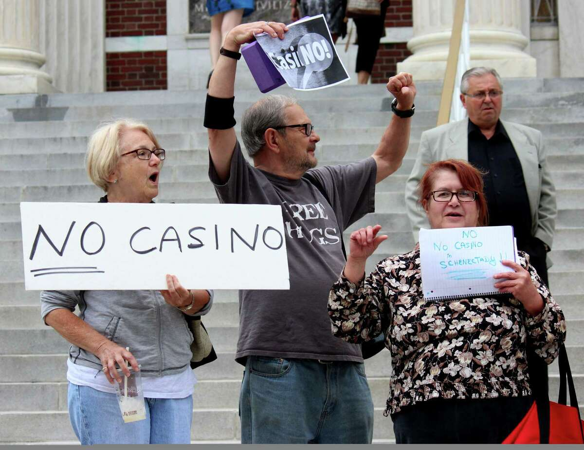 Marsha Pompilio, left, Frank Ralbovsky, center, and Elaine Willi, right, expressed their concerns over plans to build a proposed Schenectady casino during a demonstration Monday evening, June 9, 2014, outside City Hall prior to a meeting of the Schenectady City Council in Schenectady, N.Y. Members of the public were given an opportunity to address their concerns to Council members prior to a voting on whether to support the Erie Blvd. casino plan. (Selby Smith / Special to the Times Union)