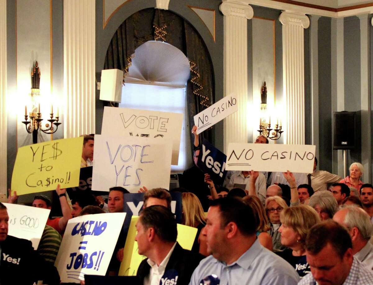 Demonstrators both for and against a proposed Schenectady casino plan Monday evening, June 9, 2014, at City Hall during a meeting of the Schenectady City Council in Schenectady, N.Y. Members of the public were given an opportunity to address their concerns to Council members prior to a voting on whether to support the Erie Blvd. casino plan. (Selby Smith / Special to the Times Union)