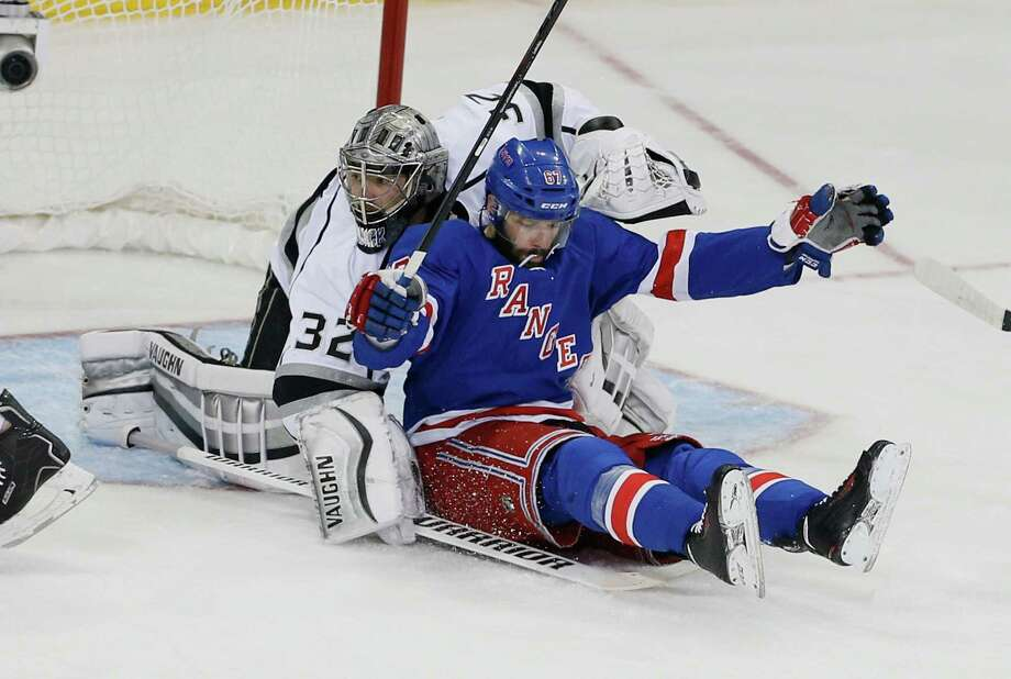 The Rangers couldn't put anything past Kings goalie Jonathan Quick, including 32 shots and forward Martin St. Louis after a second-period collision. Photo: Paul Bereswill, Stringer / 2014 Getty Images