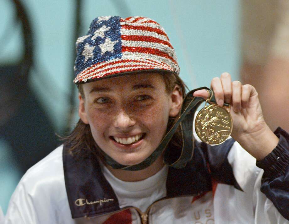 Amy Van Dyken Rouen, injured in an all-terrain vehicle accident, won the women's 50-meter freestyle at the 1996 Games in Atlanta for one of the six Olympic gold medals she earned in her career. Photo: LYNNE SLADKY, STF / AP