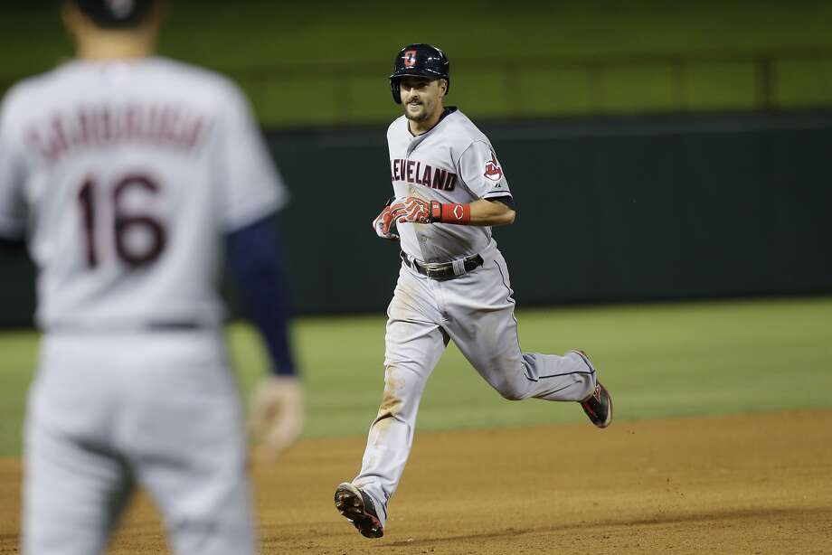 Lonnie Chisenhall, right, drove in nine runs, tying a Cleveland record, and hit three homers among his five hits in a 17-7 win at Texas on Monday. Photo: LM Otero, Associated Press