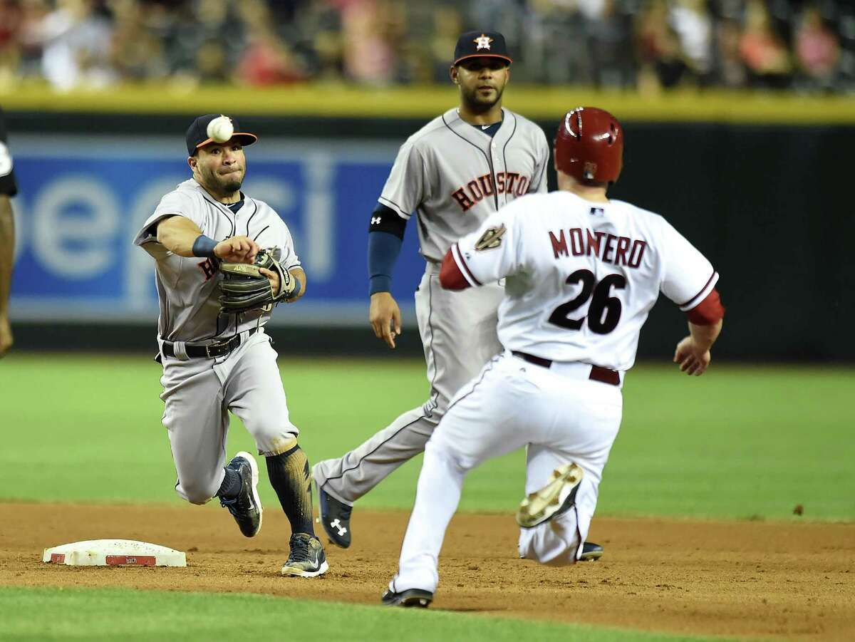 Jose Altuve makes a quick turn of a double play in the fourth inning before the Diamondbacks' Miguel Montero can get close to the Astros second baseman.